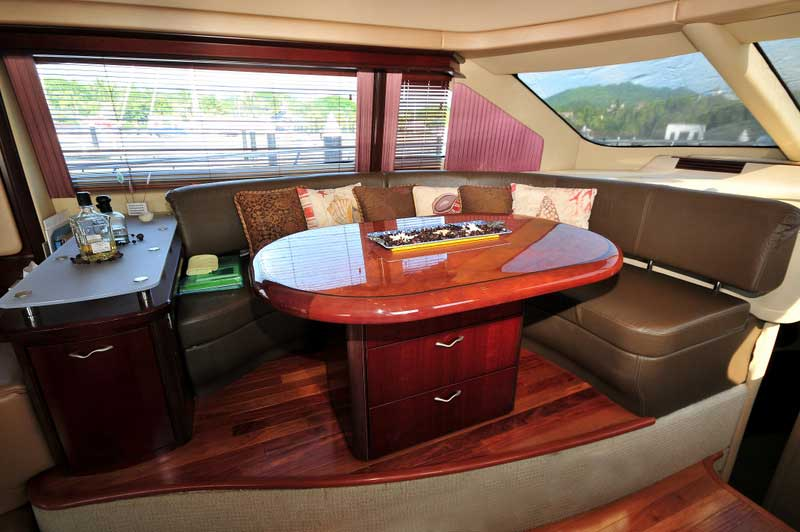 60 ft. Sea Ray - Luxury Power Yacht - Sliding-table-transforms-a-dinette-into-a-lounge-bar
