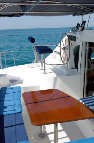38 FT Lagoon Catamaran; Up to 20 People – (max. 8 to Marieta Islands)-benched-seating-table2